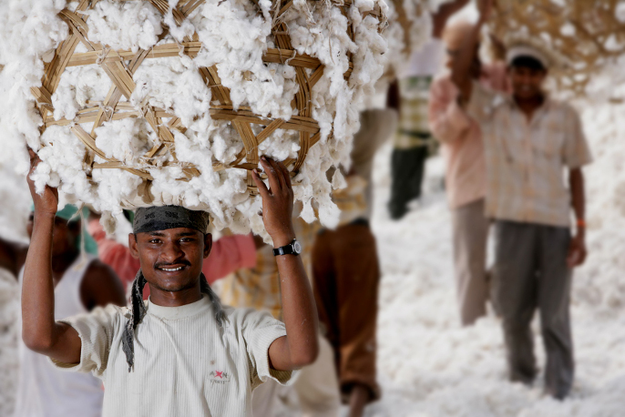 Piccalilly Way - Cotton worker carrying cotton on their head